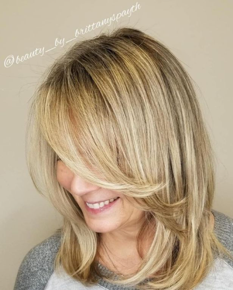 Medium Feathered Blonde Cut